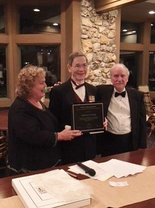 Jean Noonan and John Ropiequet present Larry Young with the 2018 Lifetime Achievement Award on April 14, 2018.