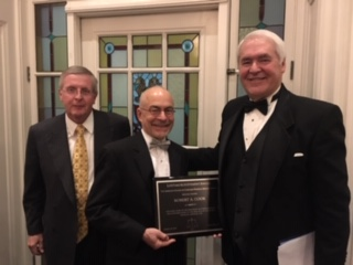 Joe Lynyak and Bob Chamness present Robert Cook with the 2019 Lifetime Achievement Award on March 30, 2019.